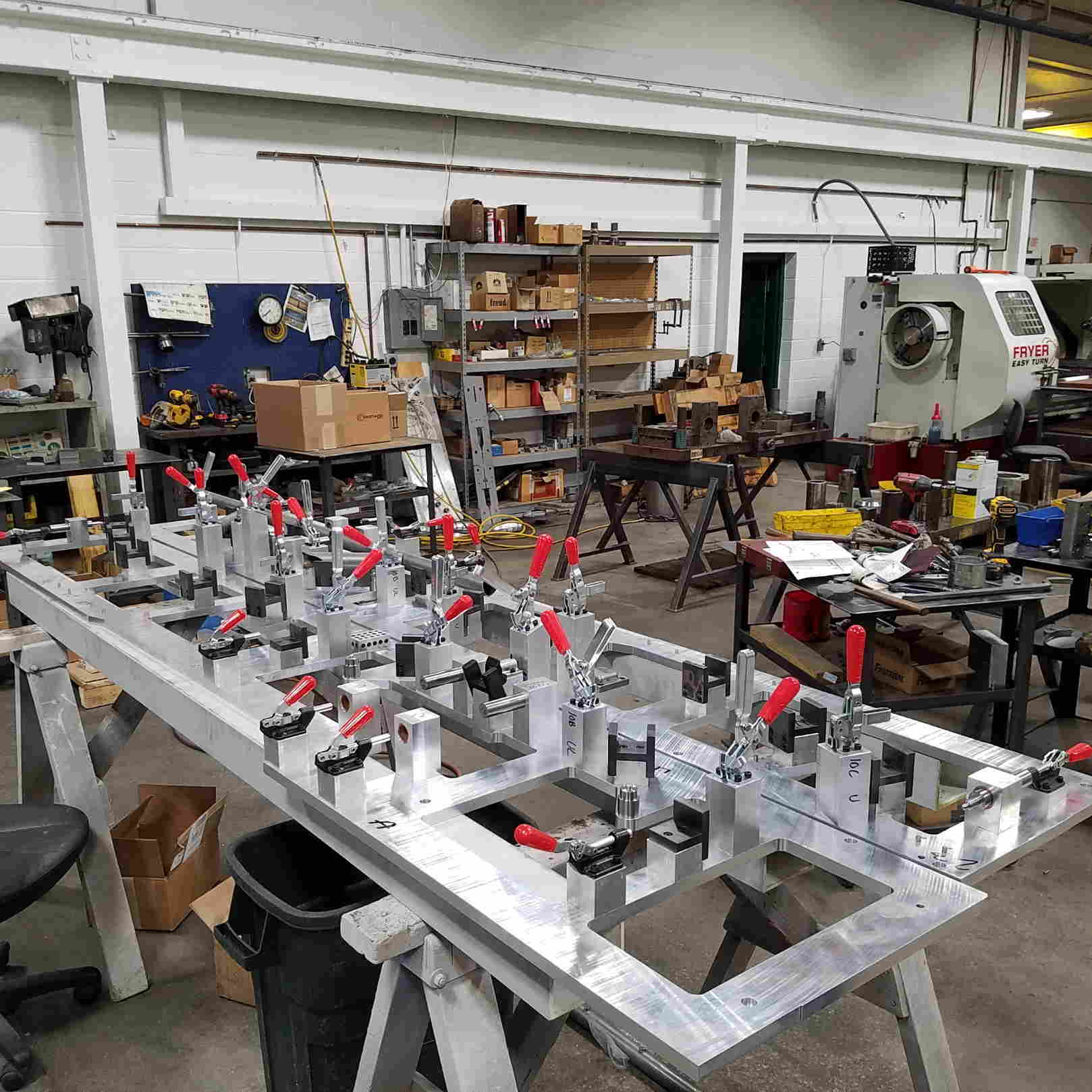 Welding Fixture in our assembly area, fixtures in foreground
